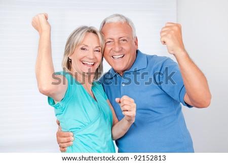 Portrait of cheerful senior man with happy mature woman - stock photo