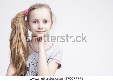 Portrait of Cheerful Smiling Caucasian Female Blond Kid. Posing Against White Background. Horizontal Image Composition - stock photo