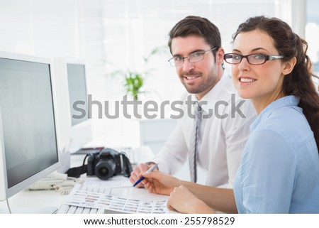 Portrait of cheerful team working together in the office - stock photo