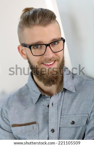 Portrait of cheerful trendy young man