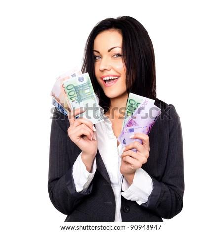 Portrait of cheerful woman holding money - stock photo