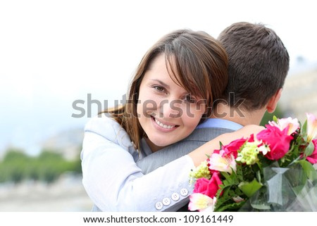 Portrait of cheerful woman who just received flowers - stock photo