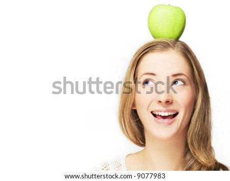 portrait of cheerful woman with apple on her head, over white - stock photo