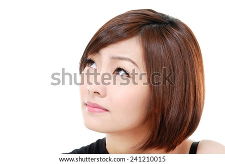 portrait of cheerful young asian girl - looking up   - stock photo