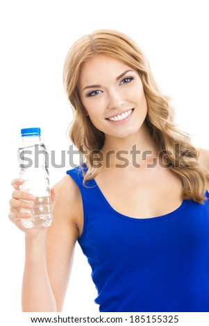 Portrait of cheerful young attractive blond woman with bottle of water, isolated over white background - stock photo