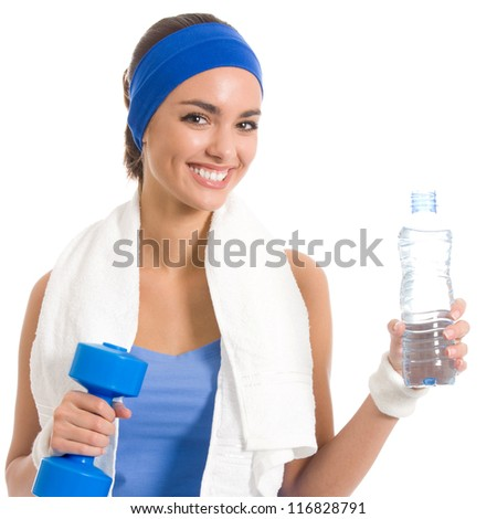 Portrait of cheerful young attractive woman in fitness wear with dumbbell and water, isolated over white background - stock photo