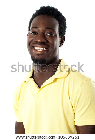 Portrait of cheerful young black teenager smiling at camera - stock photo