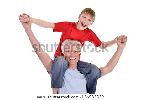 portrait of cheerful young boy and his grandfather on white background