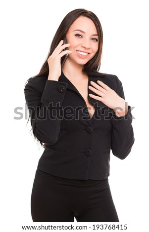 Portrait of cheerful young brunette talking on the phone. Isolated on white - stock photo