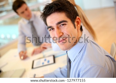 Portrait of cheerful young businessman - stock photo