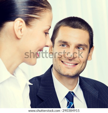 Portrait of cheerful young businesspeople or businessman and client, working at office - stock photo