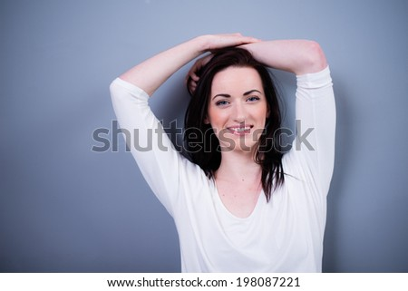 portrait of cheerful young caucasian woman with black hair and blue eyes  - stock photo