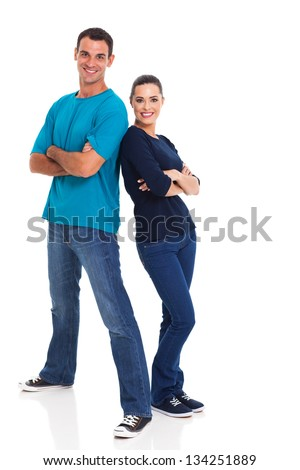 portrait of cheerful young couple leaning on each other over white background - stock photo
