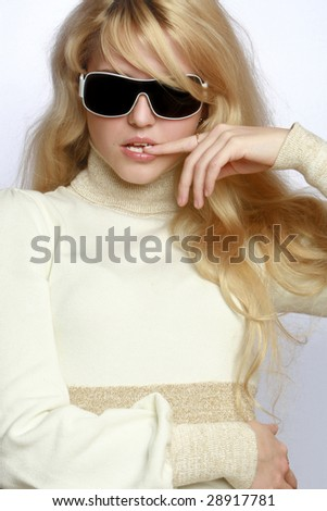 Portrait of cheerful young fashionable girl in dark glasses