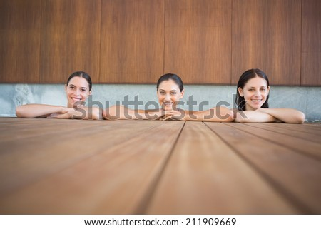 Portrait of cheerful young women in the swimming pool - stock photo