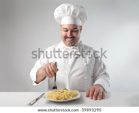 portrait of chef eating pasta