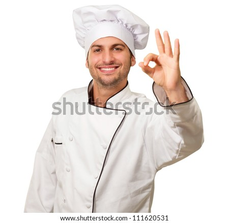 Portrait Of Chef Gesturing On White Background