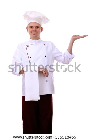 Portrait of chef holding something on his palm isolated on white