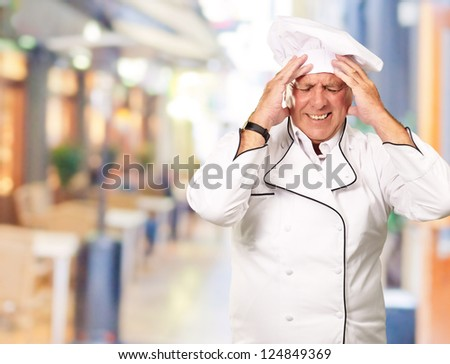 Portrait Of Chef With Painfully Head, Outdoor - stock photo