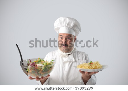portrait of chef with salad and pasta