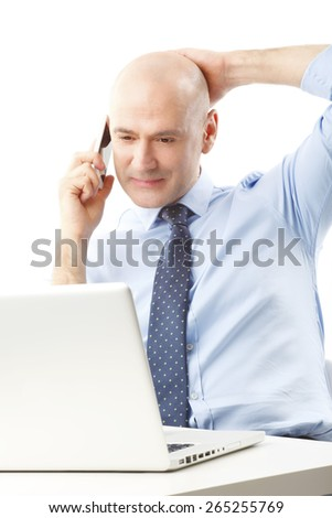 Portrait of chief financial officer sitting at office and making a call while working on presentation at laptop. Isolated on white background.  - stock photo
