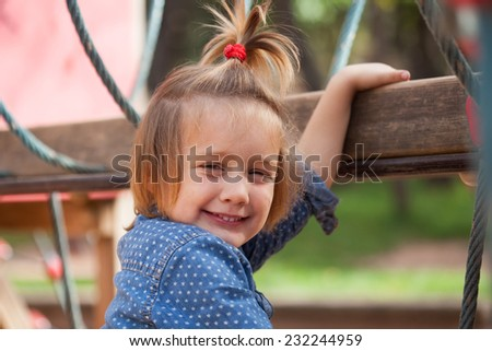 Portrait of  child  at playground  in sunny summer day