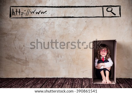 Portrait of child businessman in cardboard box. Think outside the box business concept. Internet security - stock photo