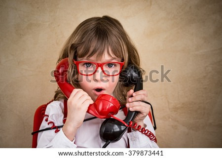 Portrait of child businessman in office. Communication business concept - stock photo