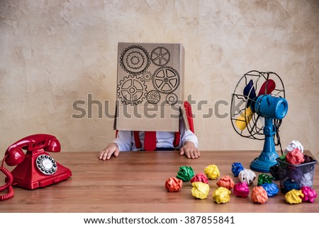Portrait of child businessman in office. Think outside the box business concept - stock photo