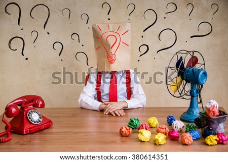 Portrait of child businessman in office. Think outside the box business idea concept - stock photo
