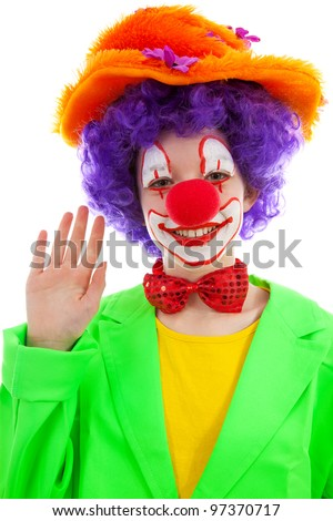 portrait of child dressed as colorful funny clown over white background - stock photo