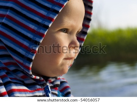 Portrait of child in profile - stock photo