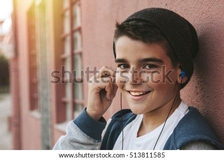 portrait of child listening to music in the city