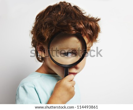 portrait of child looking closely - stock photo