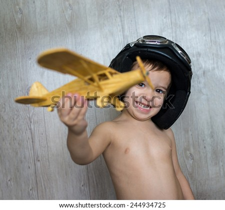 Portrait of child with airplane traveling toy - stock photo
