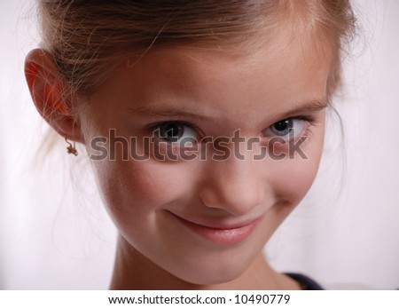 Portrait of child with amicable sight, pure grey eyes, sharp face, slim neck, small bail in ear