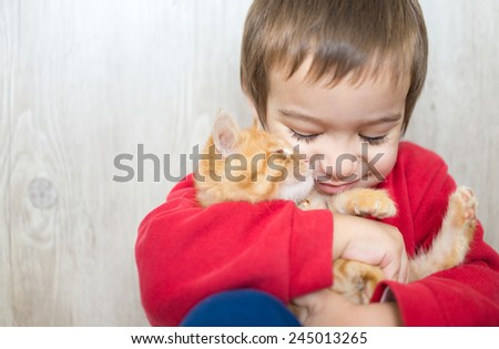 Portrait of child with cat - stock photo