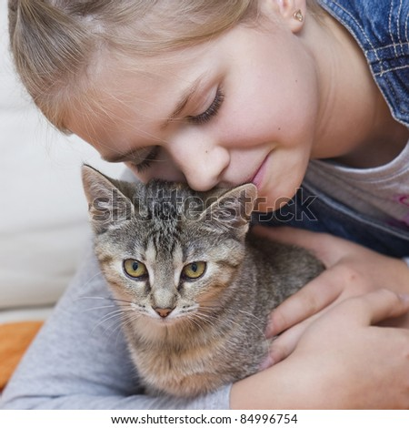 Portrait of child with kitten - stock photo