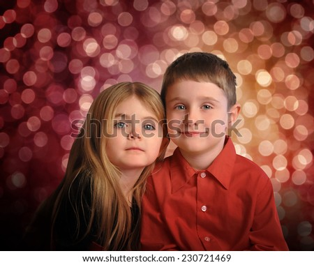 Portrait of children are smiling with colorful bokeh lights in the background for a christmas or celebration concept.