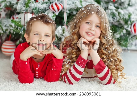 Portrait of children at the Christmas tree for Christmas - stock photo