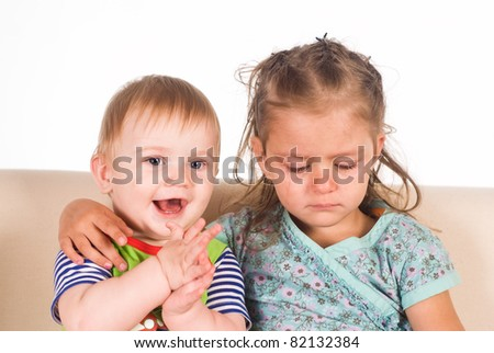 portrait of children on sofa on a white - stock photo