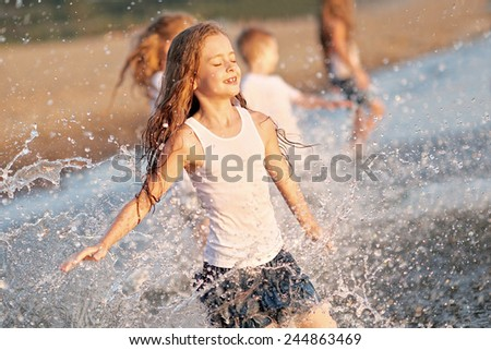 Portrait of children on the beach in summer - stock photo