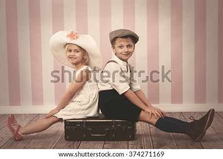 Portrait of children sitting on the chest
