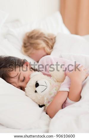 Portrait of children sleeping in a bedroom - stock photo