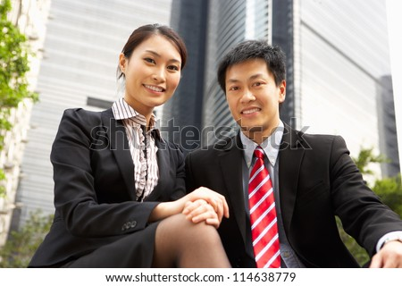 Portrait Of Chinese Businessman And Businesswoman Outside Office - stock photo