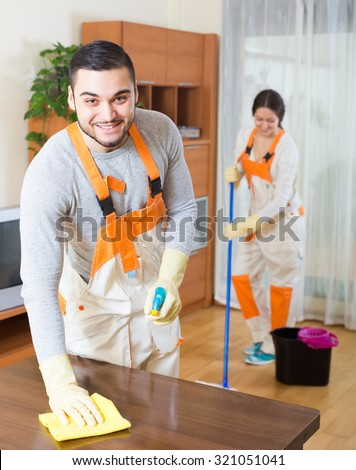 Portrait of cleaning premises team with equipment working at client house  - stock photo