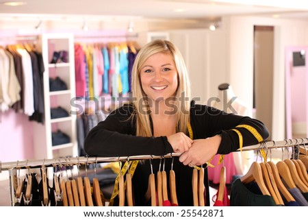 Portrait of clothing store owner - stock photo