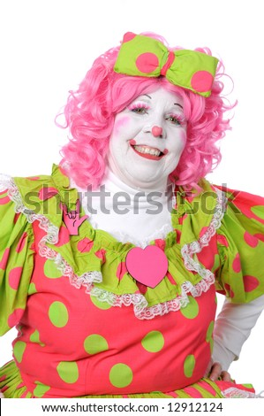 Portrait of clown with pink hair smiling - stock photo