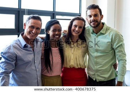 Portrait of colleagues posing together in the office - stock photo