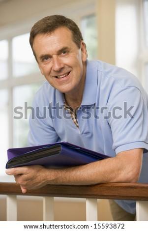 Portrait of college professor in university corridor - stock photo